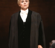 <span class=gallery-multiple>The court assembles to judge whether Shylock can cut the pound of flesh from Antonio. Portia arrives in the Venetian courtroom disguised as the male legal expert Doctor Balthazar. Unknown to her husband Bassanio, she plans to speak in Antonio's defence. | A major challenge when playing Portia is to show her transformation from very female mistress of her Belmont household to expert (male) legal advocate. How effectively has this actor made the change? Give your reasons. | Royal Shakespeare Company, 1981 (Act 4 Scene 1)</span>