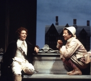 <span class=gallery-multiple>In Olivia's orchard, her fool Feste engages Viola-Cesario in a sequence of word play. He jokes about the slipperiness of language, about Viola-Cesario herself, and about the foolishness of husbands. Viola-Cesario is talked into paying Feste money.|How does the designer make it clear to the audience that this scene is set outdoors? What aspects of the actors' body language and facial expressions suggest that Feste is clowning or that Viola is amused?|Donald Cooper/Photostage</span>